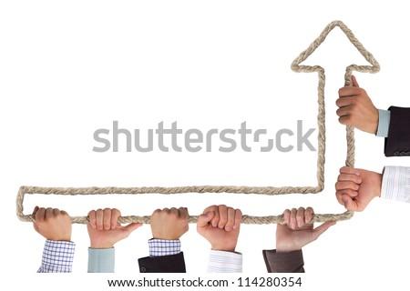 Hands holding arrow pointing upwards - stock photo