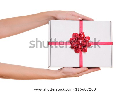 Hands holding beautiful gift box, female giving gift, Christmas holidays and greeting season concept, shallow dof - stock photo