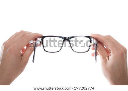 hands holding black glasses on white background - stock photo