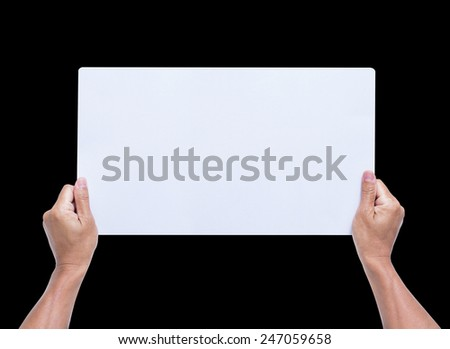 Hands holding blank paper isolated on black background