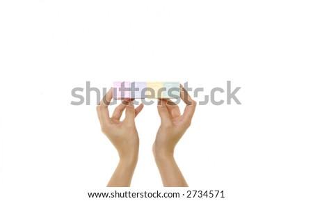 "Hands holding blocks spelling ""Baby"" - stock photo"