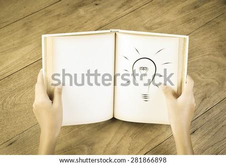 Hands holding book , idea concept - stock photo