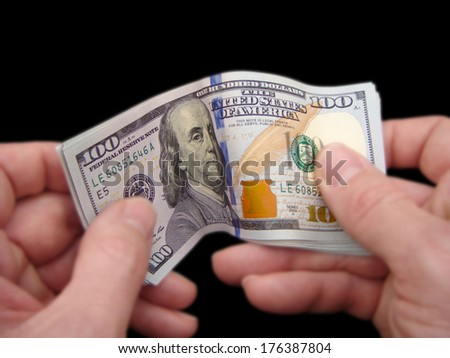 Hands Holding Brand New United States One Hundred Dollar Federal Reserve Notes, Showing The Obverse Design Waved. - stock photo