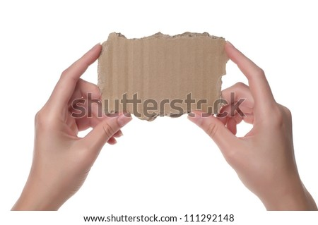 Hands holding cardboard paper isolated on white - stock photo