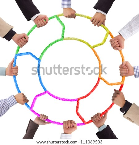 Hands holding colorful rope forming circle