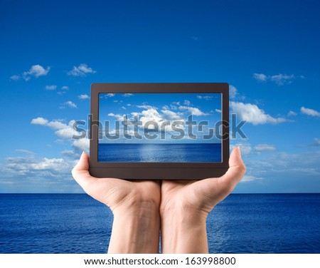 hands holding computer laptop smart phone tablet and touch pad - stock photo