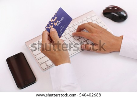 Hands holding credit card and using Computer. Online shopping