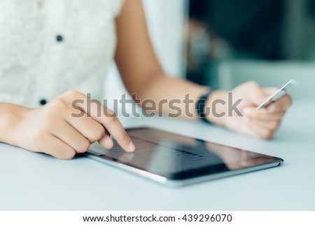 Hands holding credit card and using tablet. Online shopping