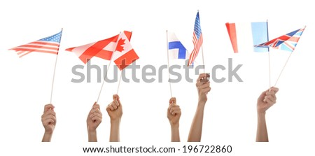 Hands holding different flags, isolated on white - stock photo