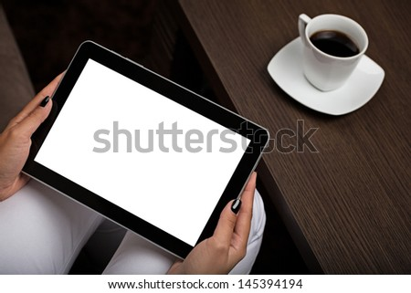 Hands holding Digital Tablet in a office - stock photo