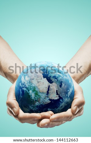 hands holding earth on white background