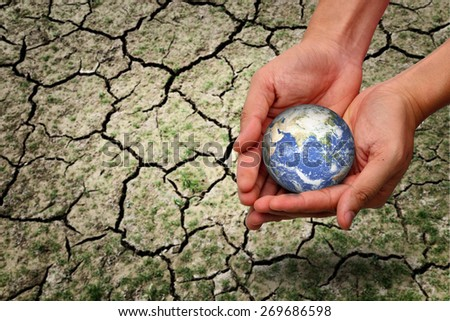 hands holding earth / save the world / environmental problems / love nature / heal the world - stock photo