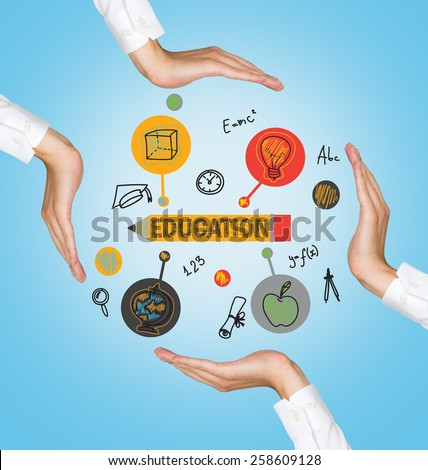 hands holding education icons on blue background - stock photo