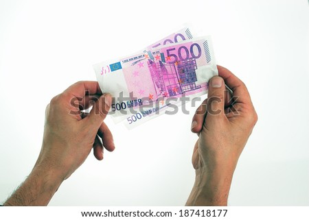 hands holding euro notes over white