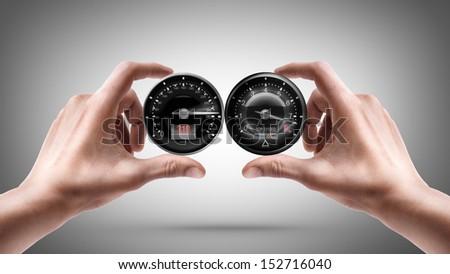 hands holding External tachometer - stock photo