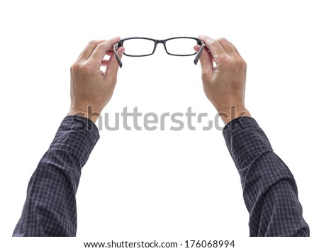 Hands holding eyeglasses isolated on white background, clipping path - stock photo