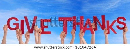 hands holding four pieces of a puzzle with copy space, gray background - stock photo
