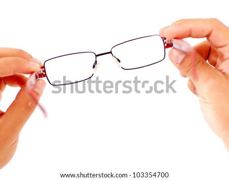 Hands holding glasses - isolated over a white background - stock photo