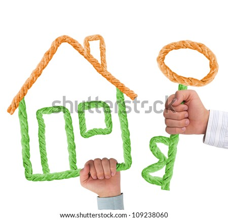Hands holding house and key isolated on white - stock photo