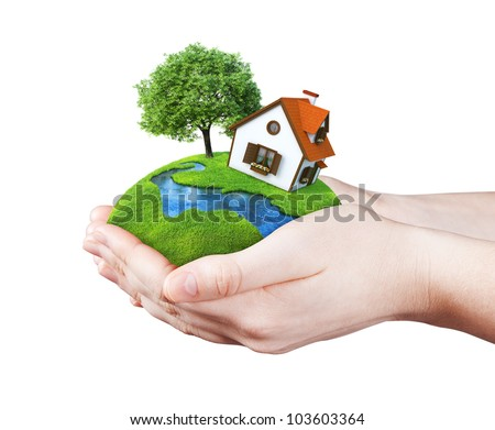 Hands holding house on clear green meadow, tree and river. Concept for growing business, ecology, freshness, freedom and other lifestyle issues. Green fields collection. - stock photo