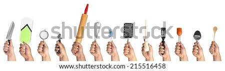 Hands holding kitchen utensils on a white background - stock photo