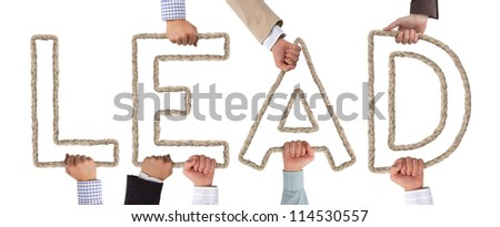 Hands holding letters forming Lead tag