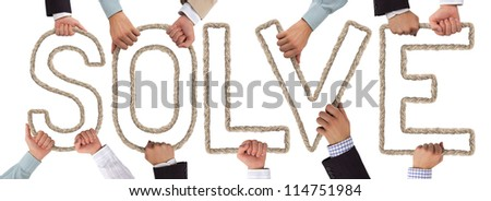 Hands holding letters forming SOLVE tag