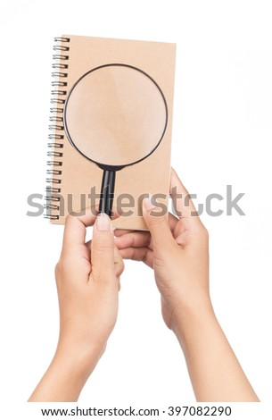 Hands holding magnifying glass isolated on white background - stock photo