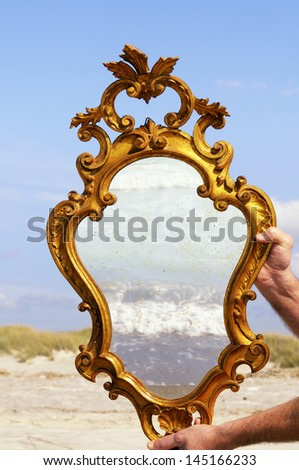 Hands Holding Mirror
