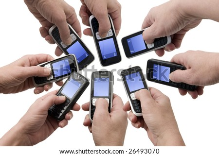 Hands holding mobile phones with empty text message boxes - stock photo