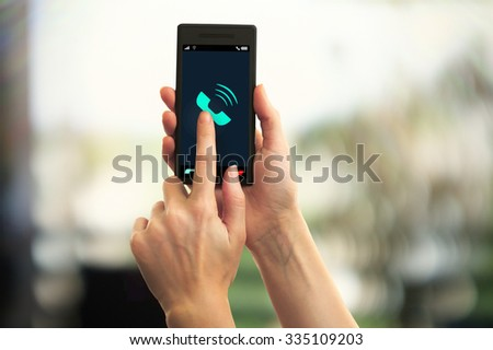 Hands holding mobile smart phone on abstract background