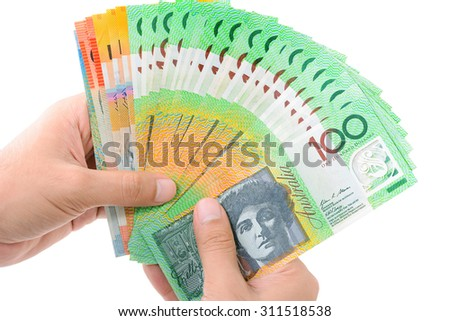 Hands holding money, Australian dollar (AUD) banknotes, isolated on white background - stock photo