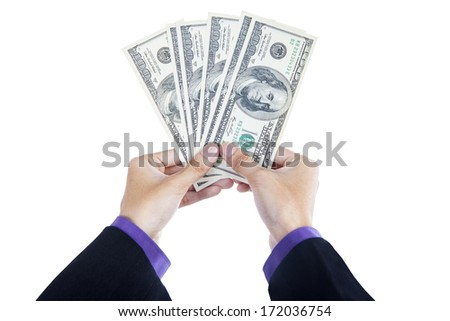 Hands holding money isolated on a white background - stock photo