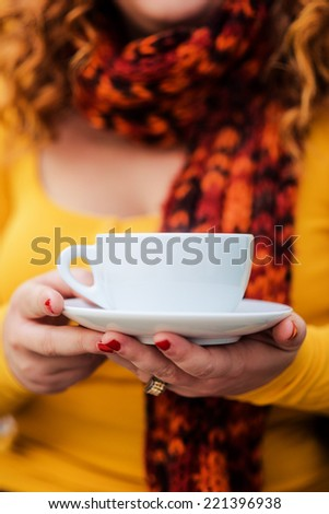 hands holding mug of hot drink - stock photo