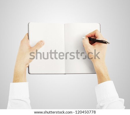 hands holding notebook and drawing - stock photo