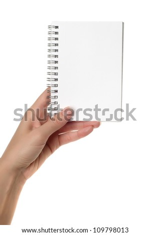 Hands holding notebook isolated on white