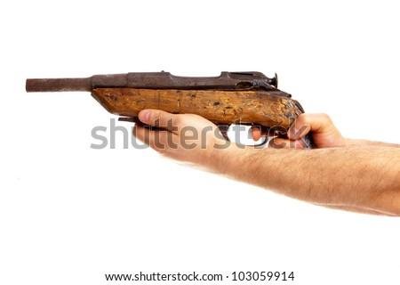 Hands holding old handmade shotgun isolated on white background - stock photo
