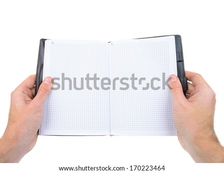 Hands holding opened leather notebook isolated on white - stock photo