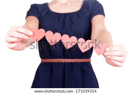 Hands holding paper hearts isolated on white - stock photo