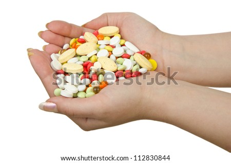Hands holding pills on white - stock photo