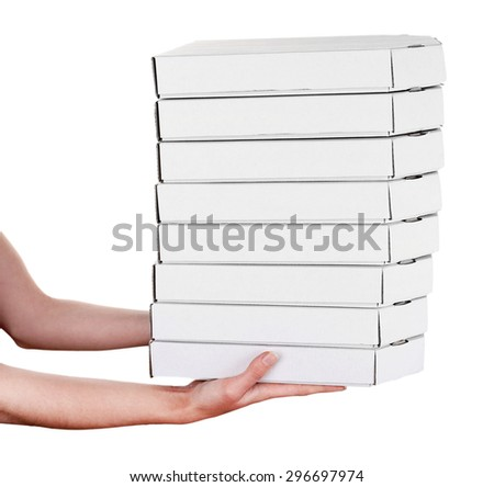 Hands holding pizza boxes isolated on white - stock photo