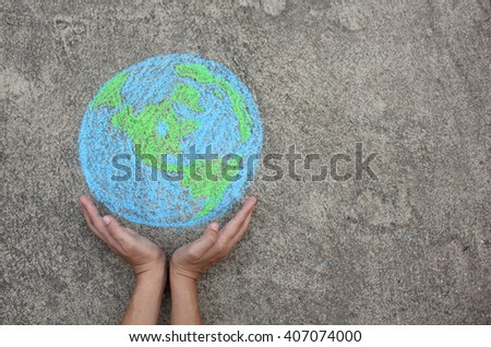 Hands holding planet Earth with copy space (drawing with chalk) - stock photo