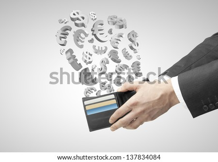 hands holding purse with flying dollars and euros