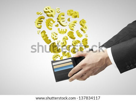 hands holding purse with flying gold dollars and euros