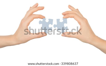 Hands holding puzzle pieces on isolated white background