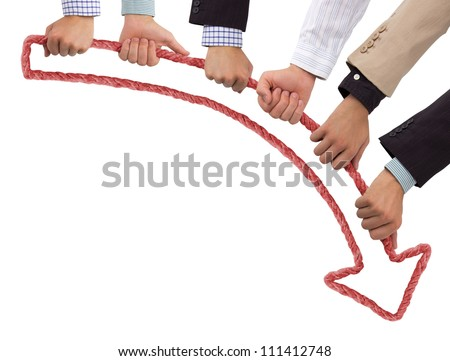 Hands holding red arrow pointing downwards - stock photo