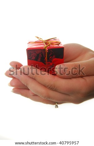 hands holding red gift isolated on white - stock photo