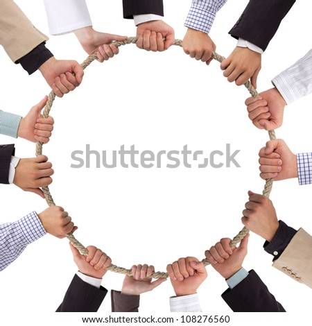 Hands holding rope forming a circle - stock photo