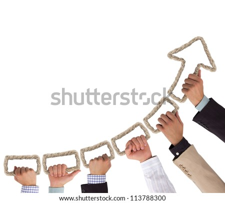 Hands holding rope forming arrow pointing upwards - stock photo