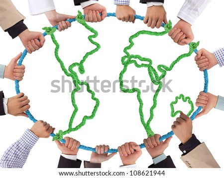 Hands holding rope forming Earth - stock photo
